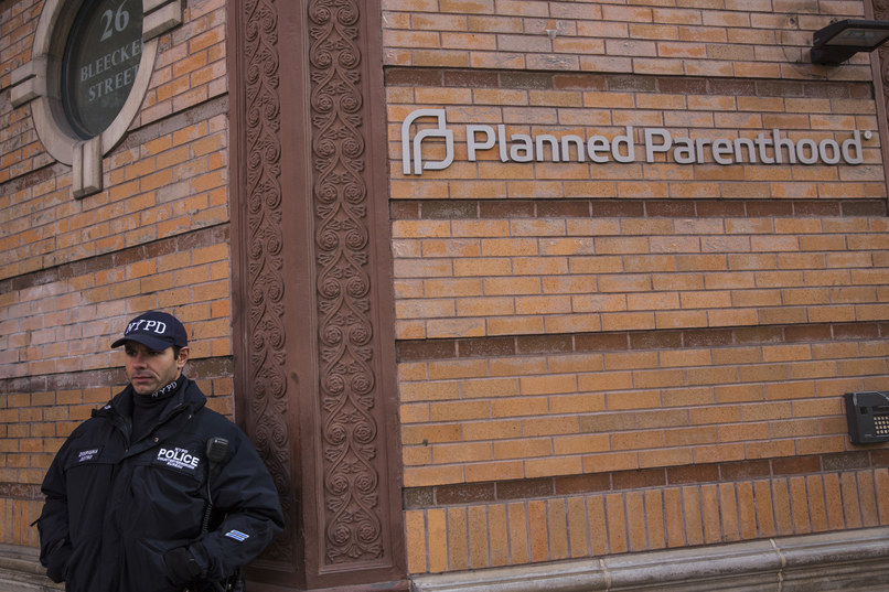 NEW YORK, NY - NOVEMBER 30:  A police officer from the counterterrorism department stands guard outside Planned Parenthood on November 30, 2015 in New York City. A gunman killed three people November 27, including a police officer, at a Planned Parenthood in Colorado Springs, Colorado. (Photo by Andrew Burton/Getty Images)